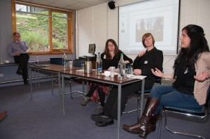 Presenters at the workshop discuss their papers